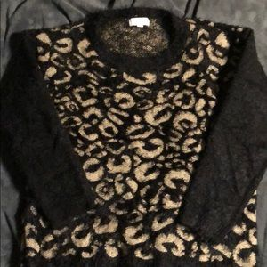 Very soft and fuzzy leopard print sweater. Size L